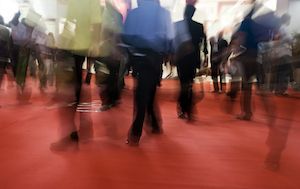 event-conference-people-walking-fast