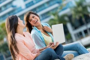 two girls at laptop
