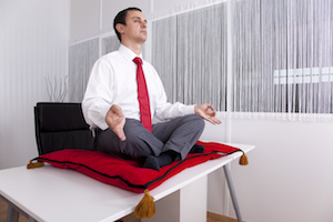meditate-meditating-man-at-office