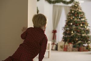 kid-peek-christmas-tree
