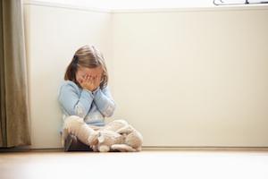 lonely-child-sitting-in-corner