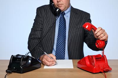 salesperson_with_2_phones