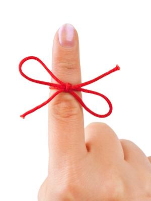 red ribbon on finger