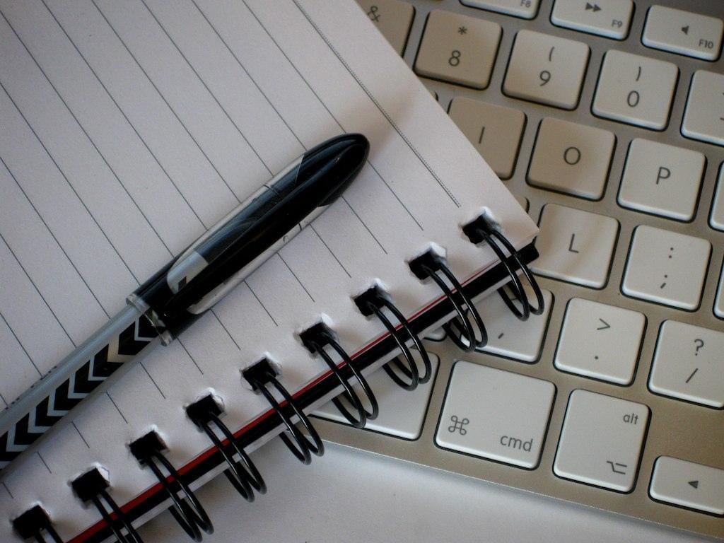 writing computer keyboard pen paper
