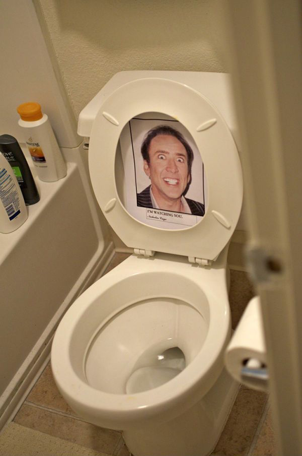 Office prank with picture of Nicolas Cage on toilet seat