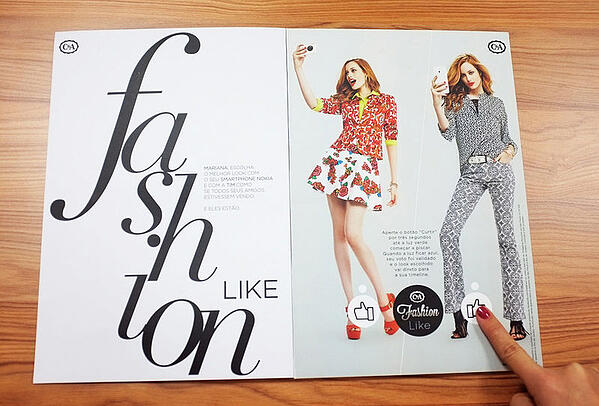 Interactive print ad by C&A fashion featuring printed social media Like buttons.