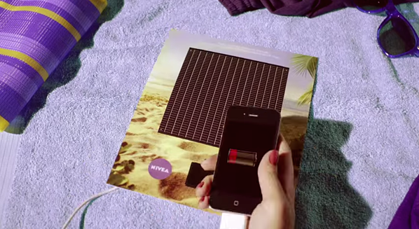 Interactive print ad by Nivea with solar-powered smartphone charger on back page of magazine.