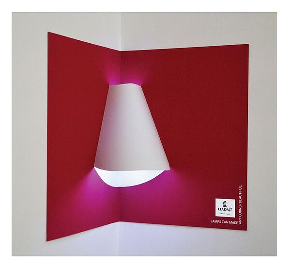 Interactive print ad by Lladro Lighting with lamp shade included in pop-up book.