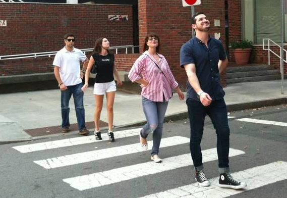 Four people on a scavenger hunt, a team building activity for large groups