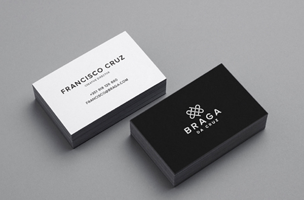 braga da cruz minimalist design on business cards with monochrome palette, sans serif font, and simple line logo