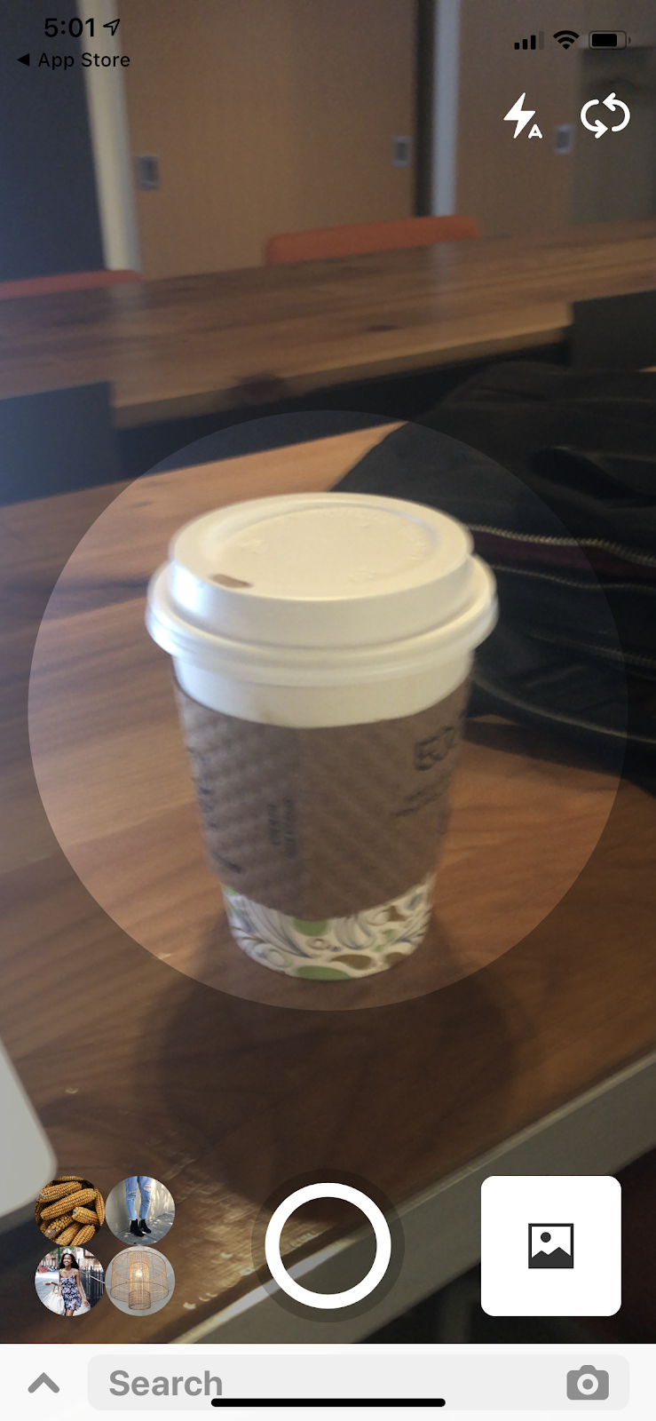 Taking a photo of a coffee cup with Pinterest's Lens Search option