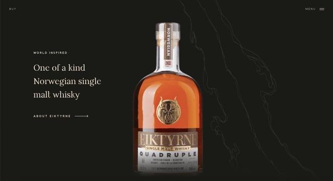 Minimalist ecommerce website Eiktyrne Whisky showcases whisky against dark background