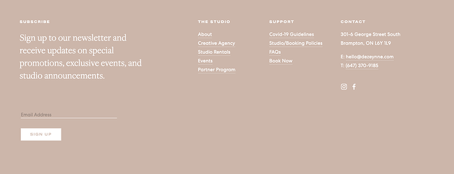 Dezeynne's minimalist website footer uses monochromatic color palette and whitespace