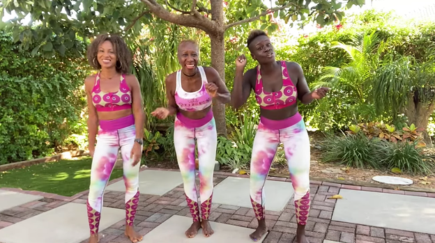 three Youtubers filming dance videos outdoors