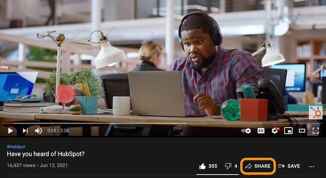 a youtube video with the share button circled