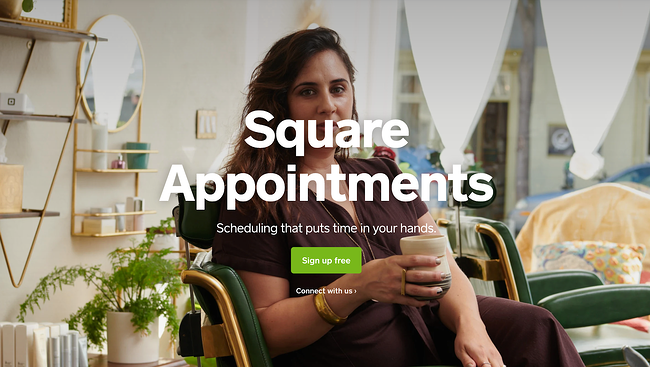 Square apointment scheduling app with an image of a woman sitting in a chair drinking a cup of coffee