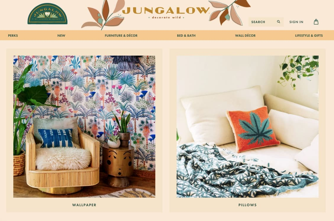 Jungalow's homepage follows IA principle of exemplars by showing images for wallpaper and pillows nav links