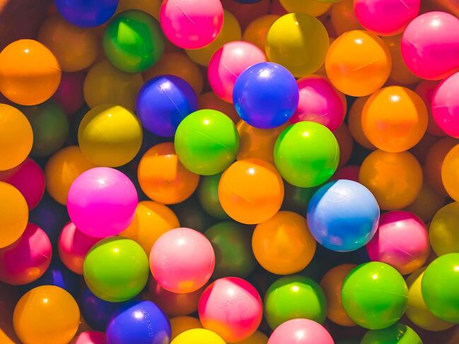 an assortment of colorful bouncy balls