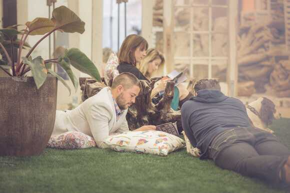 Stokpic image of a group of people reading magazines outside