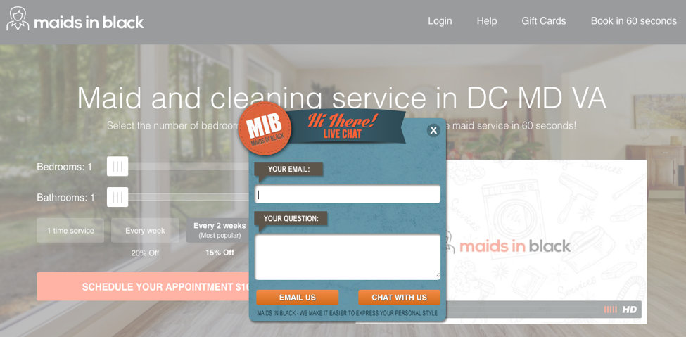 Orange and blue pre-chat form window in center of Maids In Black website