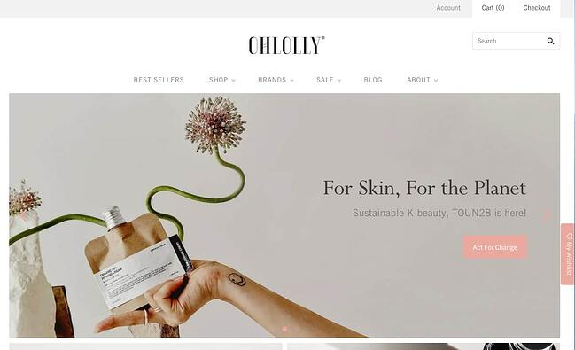OhLolly homepage featuring a hand holding a product with decorative flowers around it