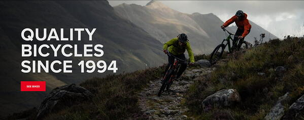 Happy customers riding Santa Cruz Bicycles up a mountain