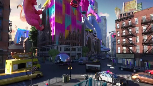 Screenshot of Adobe TV ad with a 3D-rendered city that's being drenched in Adobe's signature colors