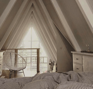 Apartment Therapy Instagram account showing bedroom in A-frame apartment
