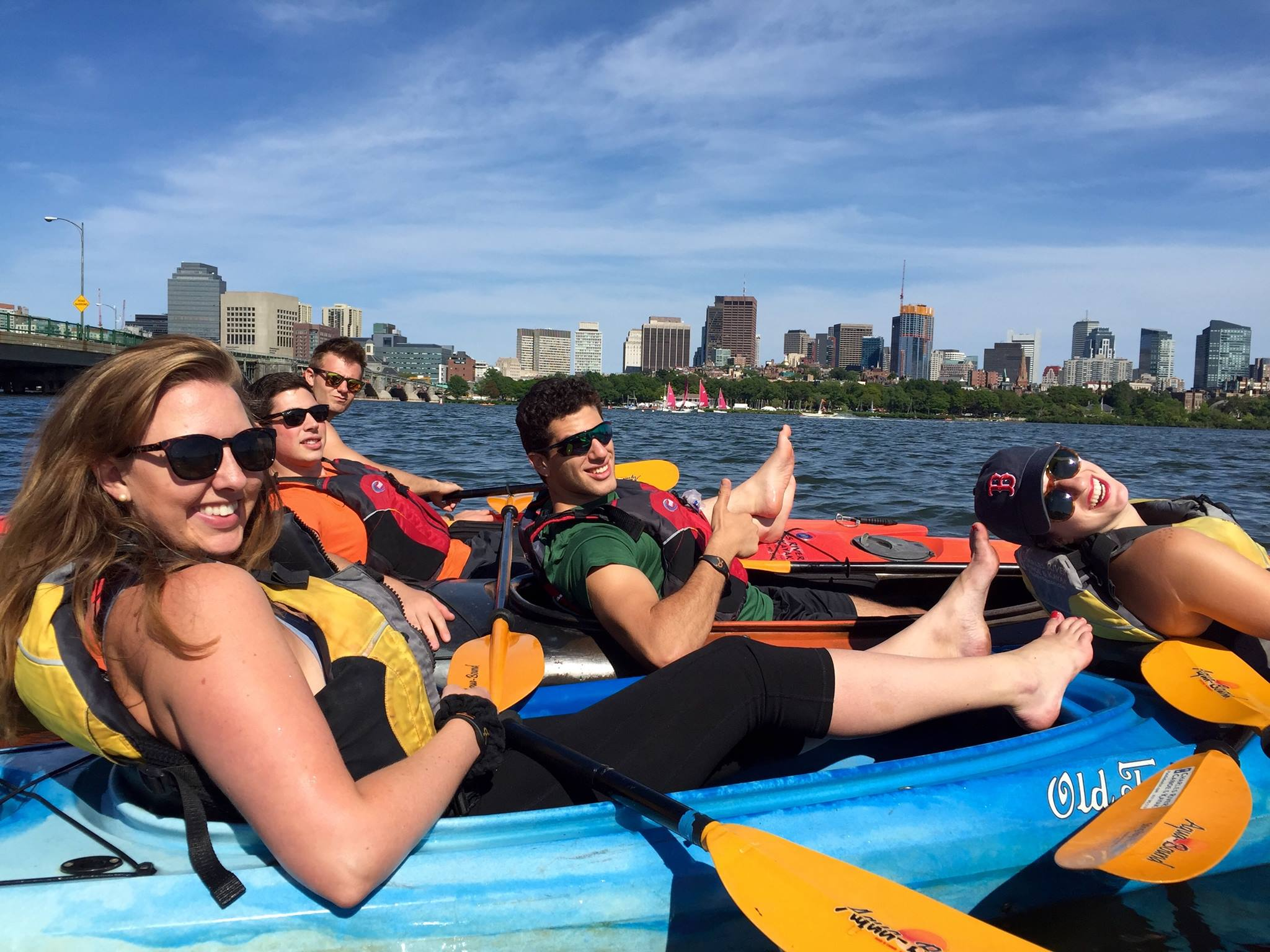Five coworkers kayaking on a company outing