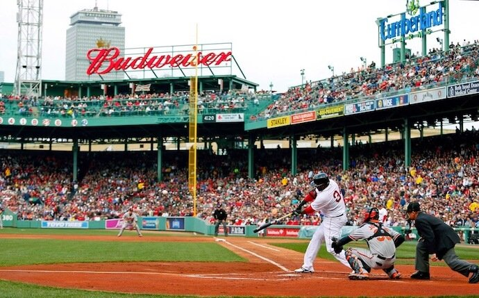 Boston Red Sox's David Ortiz striking from home plate in Fenway Park