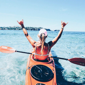 Divinity LA Bracelets Instagram account showing woman kayaking