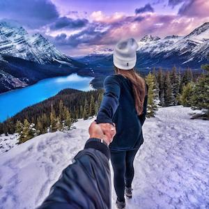 FollowMeTo Instagram account showing snow on mountains