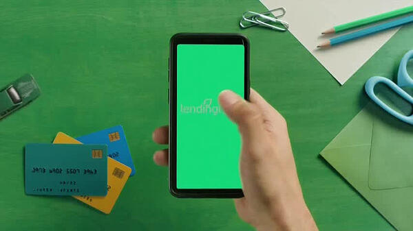 Lendingtree TV programmatic ad with a man holding a phone as he accesses the lendingtree app