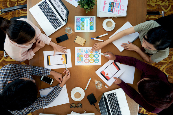 A project manager meets with colleagues to plan social projects or campaigns.