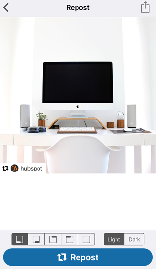 Photo of computer on Repost for Instagram app with blue button to repost photo