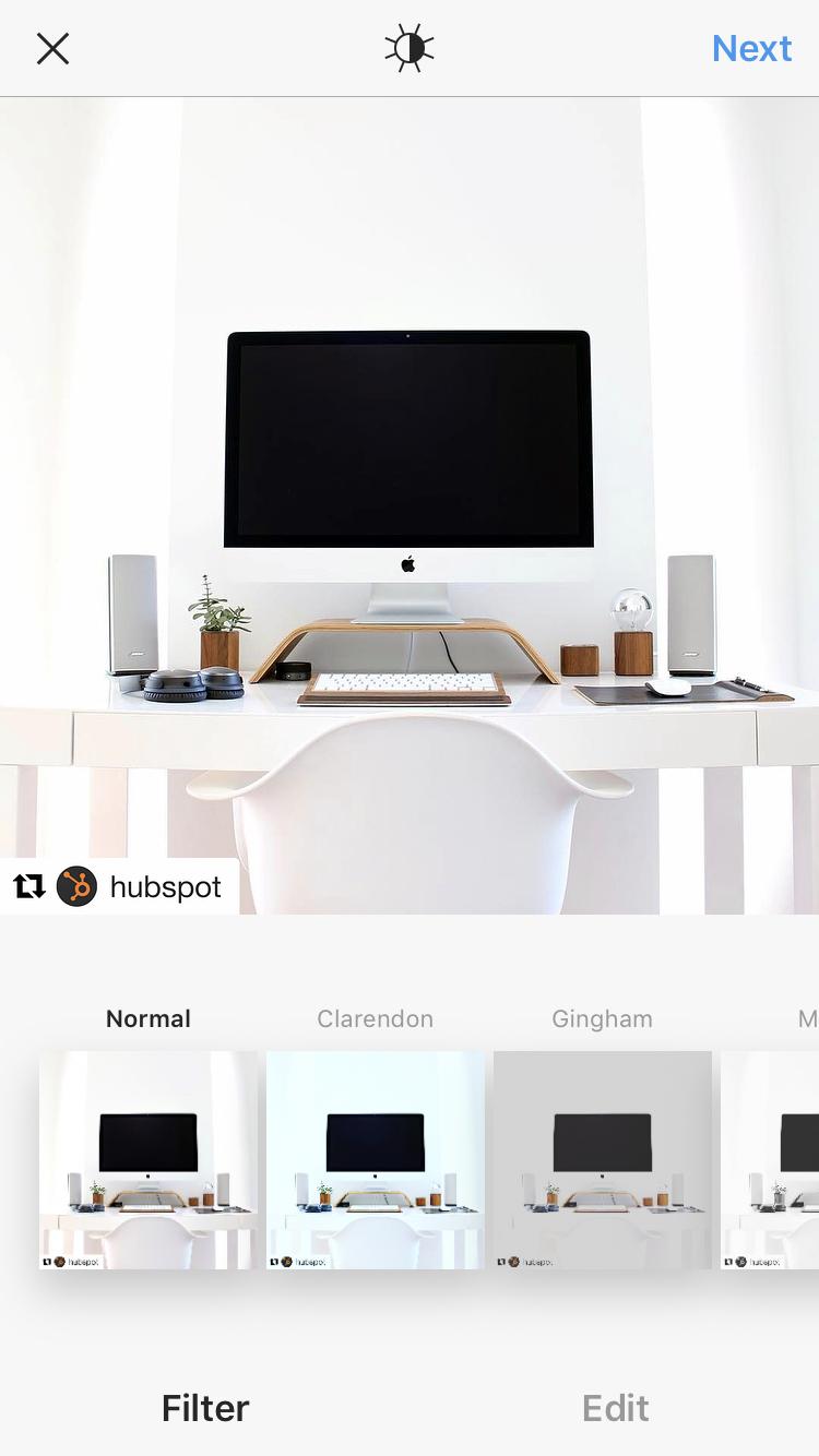 List of filters under photo of desktop computer before reposting to Instagram