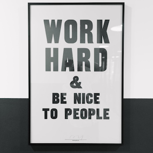 WeWork's most engaging Instagram post showing sign 'Work Hard & Be Nice to People'