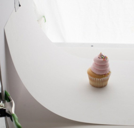 White sweep behind cupcake product photo