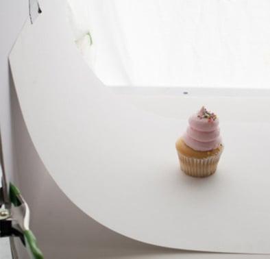 White sweep behind cupcake product photo