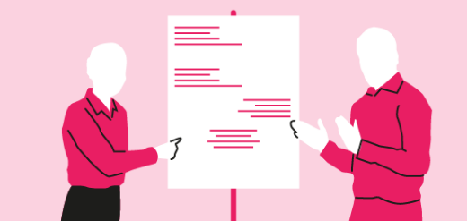 Two presenters in pink outfits using a drawing board for questioning assumptions