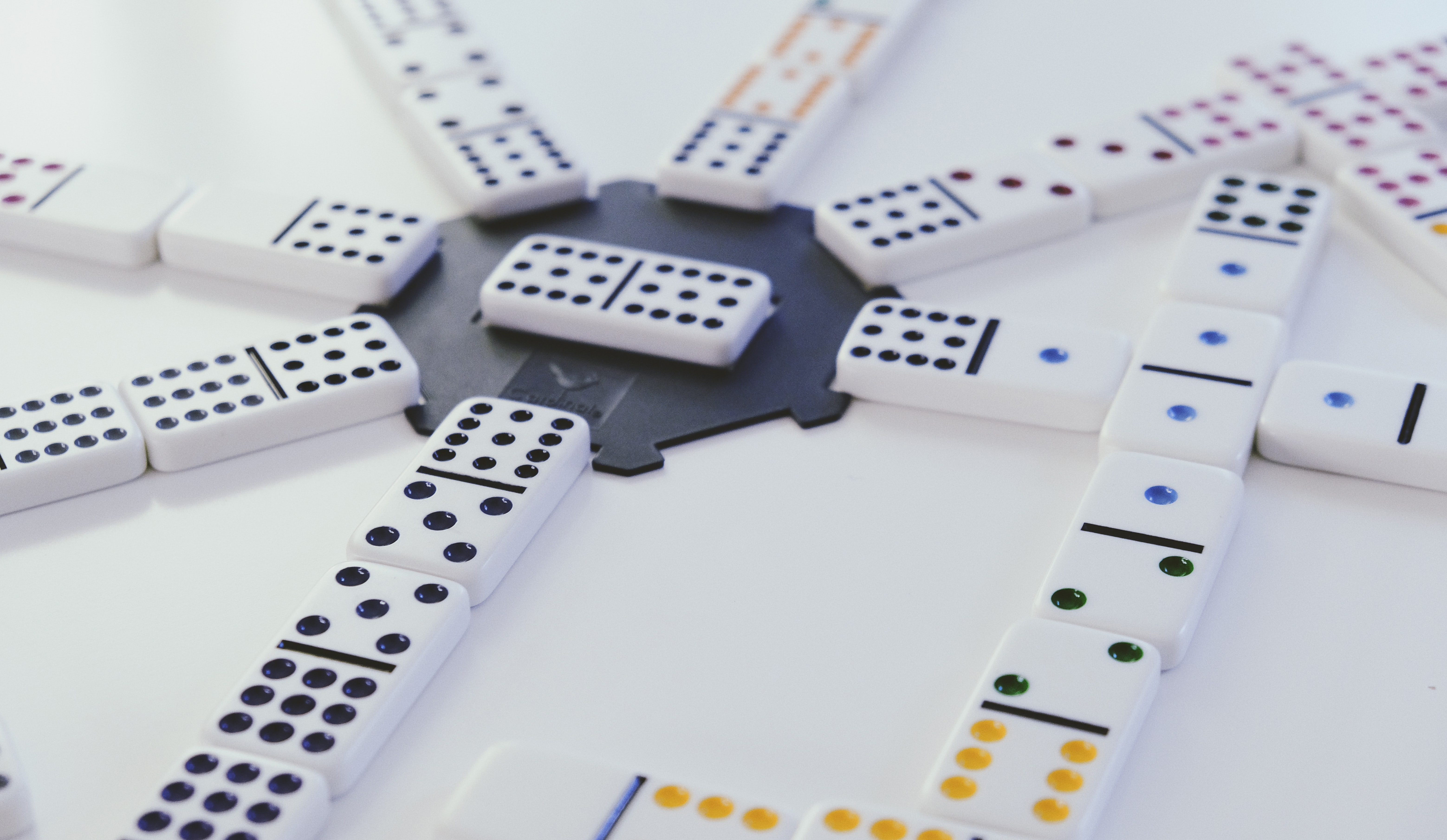 Arranged dominos lying flat, converging around a singular domino