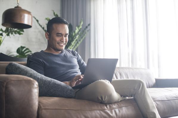 Asian man creating website footer