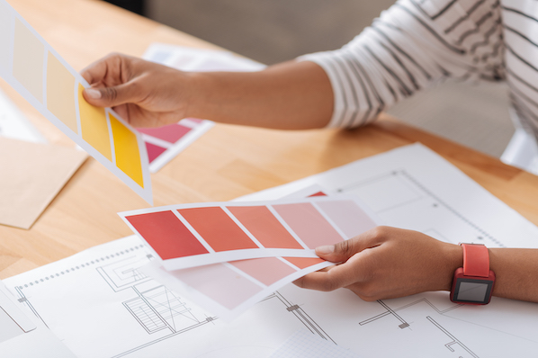 Black web designer selecting accessible color palette