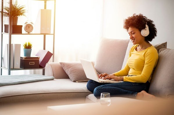 person using a laptop on a couch watching CSS animation examples