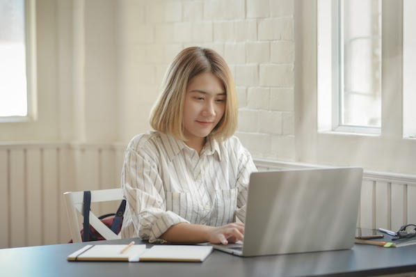 woman using a laptop computer to learn about the CSS transform property