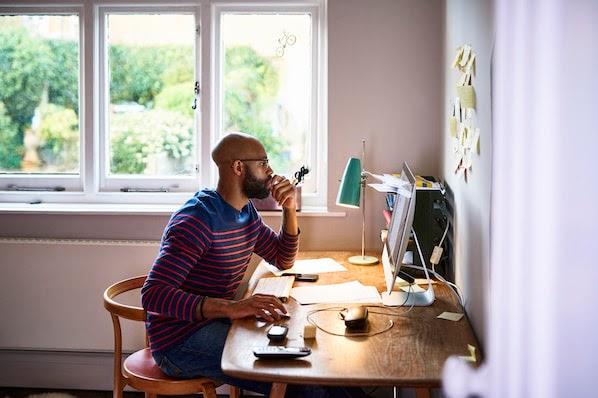 man using a desktop computer to browse google font plugins for wordpress