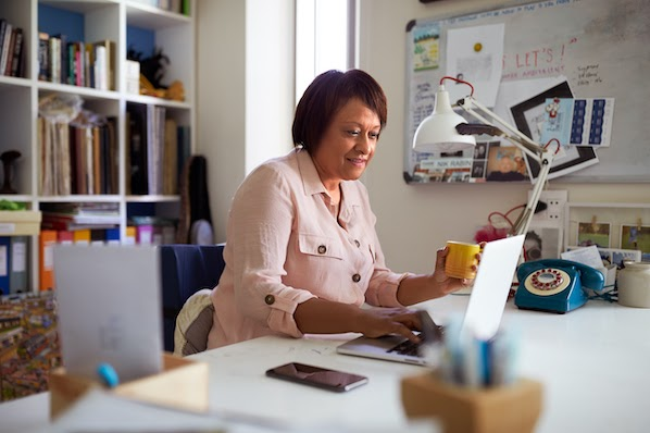 businesswoman using a computer to add Google Adsense to WordPress