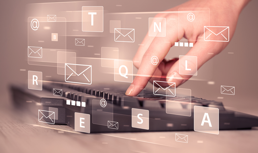 Hand typing on keyboard with digital tech icons and symbols-2