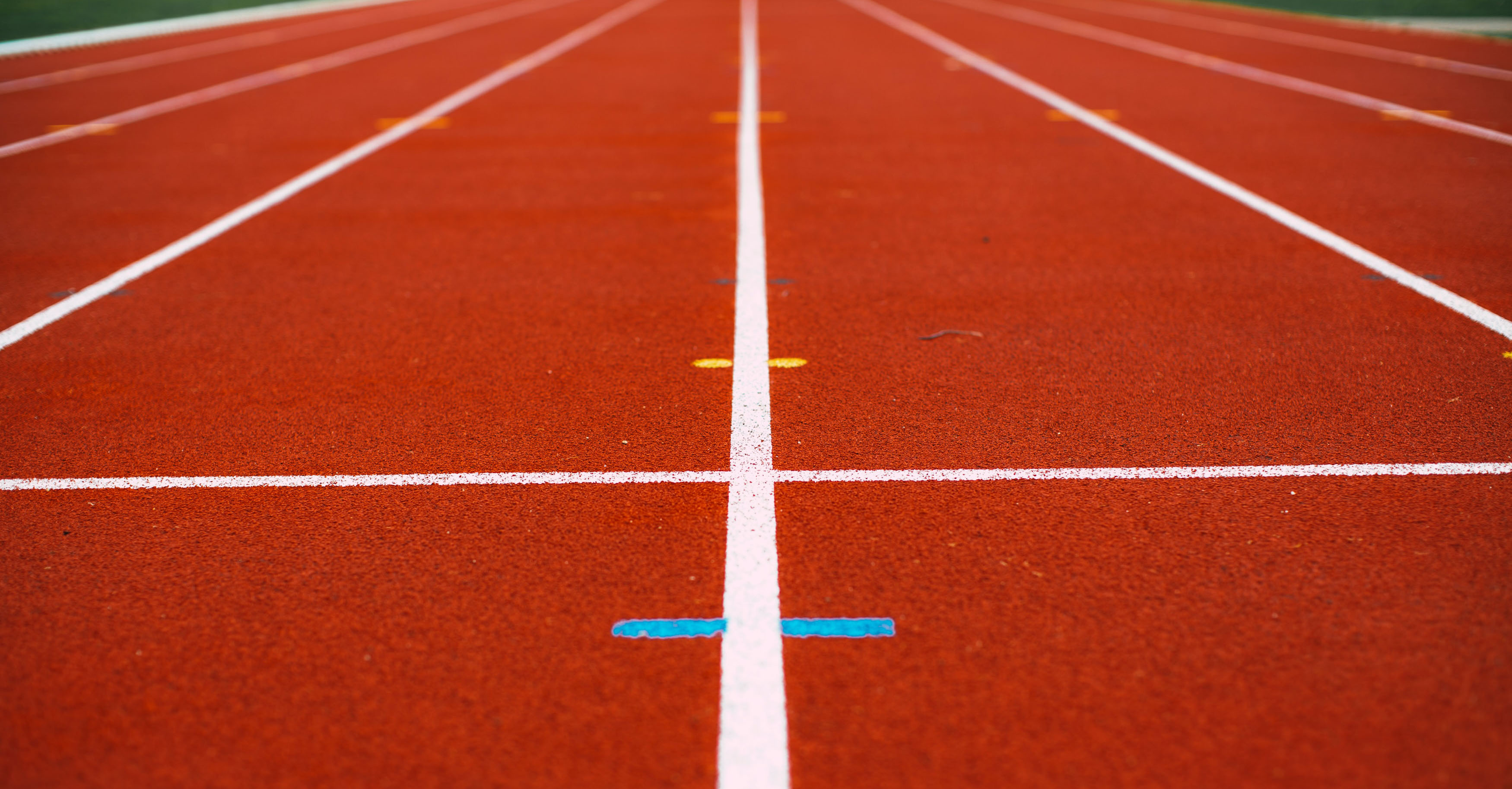 Closeup, ground view of running track lines.