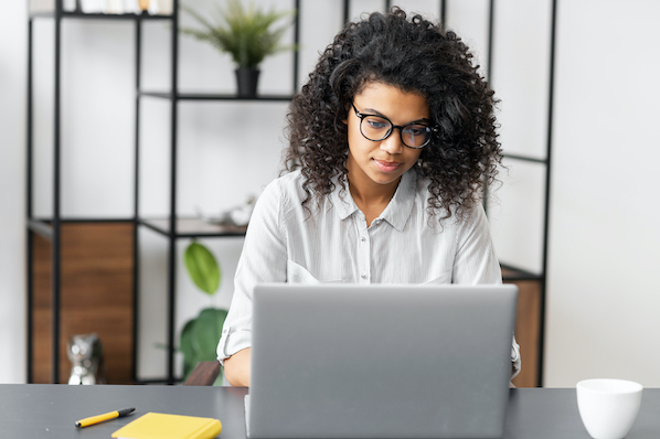 Woman installing WordPress timeline plugin